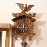 1930s antique black forest cuckoo clock working large bird wood carving in Ramstein, Germany