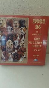 "Sealed 1000 piece puzzle by Gale Pitt titled ""Dogs 24"" in Oceanside, California"
