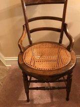 Antique oak cane seat chair in Algonquin, Illinois