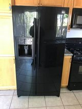 Black side-by-side refrigerator, gas stove, microwave hood, dishwashe in Nellis AFB, Nevada