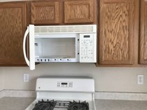 White  side-by-side door refrigerator, dishwasher, stove in Nellis AFB, Nevada