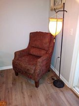Paisley gold and red comfortable arm chair with reading lamp to match in Sacramento, California