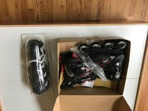 Spitfire XT Rollerblades and pads in Sugar Grove, Illinois