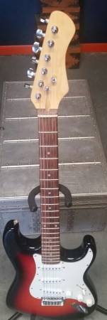 Red Tobacco Burst Stratocaster Style Electric Guitar in Chicago, Illinois