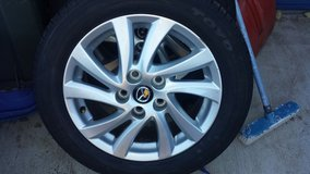 x4 17 mazda aluminum rims w/ 55 r16 toyo tubeless tire local pickup only in Fort Carson, Colorado