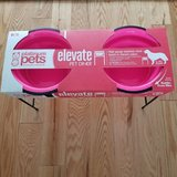 platinum pets neon pink double diner feeder with stainless steel dog bowls. in Bolingbrook, Illinois