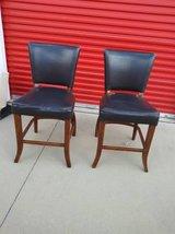 2 dark brown pleather bar stools in Roseville, California