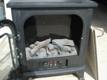 working electric fireplace heater with 2 floor grates in Naperville, Illinois