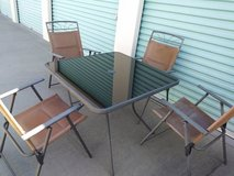 Square Glass Outdoor Table with 4 Lawn Chairs. in Roseville, California