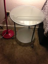 rolling 2 tier smoked glass side table.... in Roseville, California