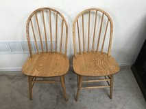 2 Oak Finish Spindle Back Chairs in Chicago, Illinois