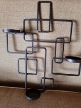 Metal candle holder wall decor in Camp Pendleton, California