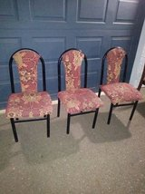 3 padded Dining chairs with floral pattern and black iron frame in Sacramento, California