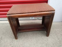 Small wood bench with Red Diamond pattern padded seat in Sacramento, California