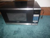 Oster 700 Watt Microwave in Naperville, Illinois