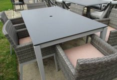 Outdoor Dining Table with 6 Wicker Style Chairs in Schaumburg, Illinois