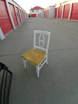 Small wood white chair with gold seat in Beale AFB, California