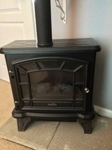 Duraflame fireplace electric heater looks like real flames in Schaumburg, Illinois