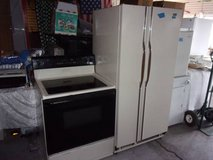 Magic Chef Refrigerator and Whirlpool Electric Glass Top Stove Set in Fort Riley, Kansas