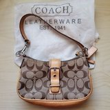 coach signature c soho beige purse with dust bag. brown leather with buckle. in Naperville, Illinois