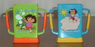 RARE Dora The Explorer Munchkin Grip n Sip Juice Box Holder Nickelodeon Lot of 2 in Yorkville, Illinois