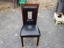 WOOD AND BLACK NAUGAHYDE CHAIR in Chicago, Illinois