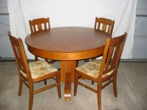 1850s Oak table and 4 matching oak chairs in Fort Carson, Colorado