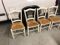 Set of 4 solid wood and sea grass dining chairs in Fairfield, California