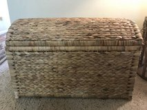 Rattan camelback storage trunk in Lakewood in Buckley AFB, Colorado