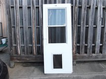 used, larson mfg co storm door, weartuff screen, white duratech, solid wood core in Fort Benning, Georgia
