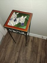 small wrought iron stand with Zebra tile top in Phoenix, Arizona