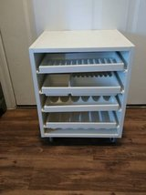 White cabinet with sliding trays rolls in Phoenix, Arizona