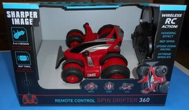 (1K) Sharper Image R/C Spin Drift 360 Red (New) in Tomball, Texas