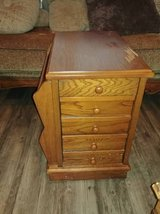 Cabinet with drawers and top drawer a cup holder magazine rack on side in Phoenix, Arizona