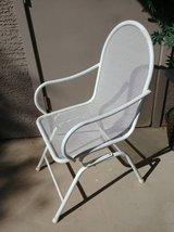 Vintage white metal outdoor chair in Phoenix, Arizona