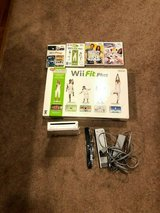 nintendo wii fit package with extra games in New Lenox, Illinois