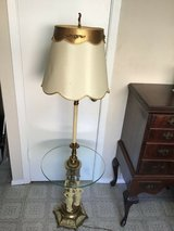 vintage hollywood regency  style brass/metal with round glass top floor table in Tomball, Texas
