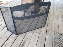 Rustic outdoor themed fireplace screen in Tomball, Texas