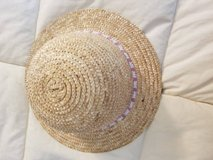 Young girls new beaded straw hat in Camp Pendleton, California