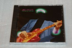 1988 dire straits cd money for nothing sealed in Kingwood, Texas