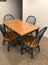 Solid wood table and chairs in Oswego, Illinois