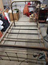 Antique full size metal headboard and footboard in Kansas City, Missouri