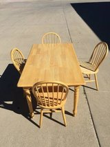"SOLID LIGHT WOOD RECTANGLE TABLE SET WITH 4 CHAIRS PICK UP ONLY 60"" X in Fort Carson, Colorado"