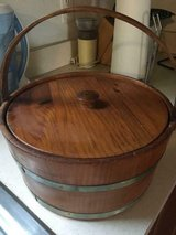 Old wooden round sewing box with handle has pin cushion inside attached in Quantico, Virginia