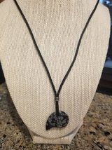 A adjustable bear fetish fossil necklace in Camp Pendleton, California